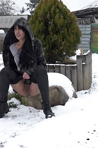 Engaging Black Haired Gal Pisses Out In The Snow
