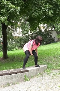 Black Haired Stunner Squatting To Piss Outdoor