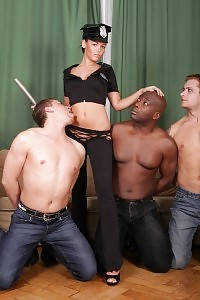 Linet Stagg Joins A Group Of Men In The Living Room For An Explicit Interracial Gang Bang Scene