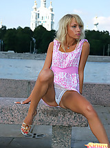 Fun loving blond can't resist flashing the camera with her white panties
