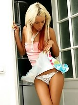 Hot blonde exposes her yummy butt in white thongs